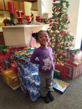 Adopt a child christmas program toy giveaway
